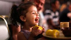 Photo Dixie-Stampede-Kid-Eating-Corn