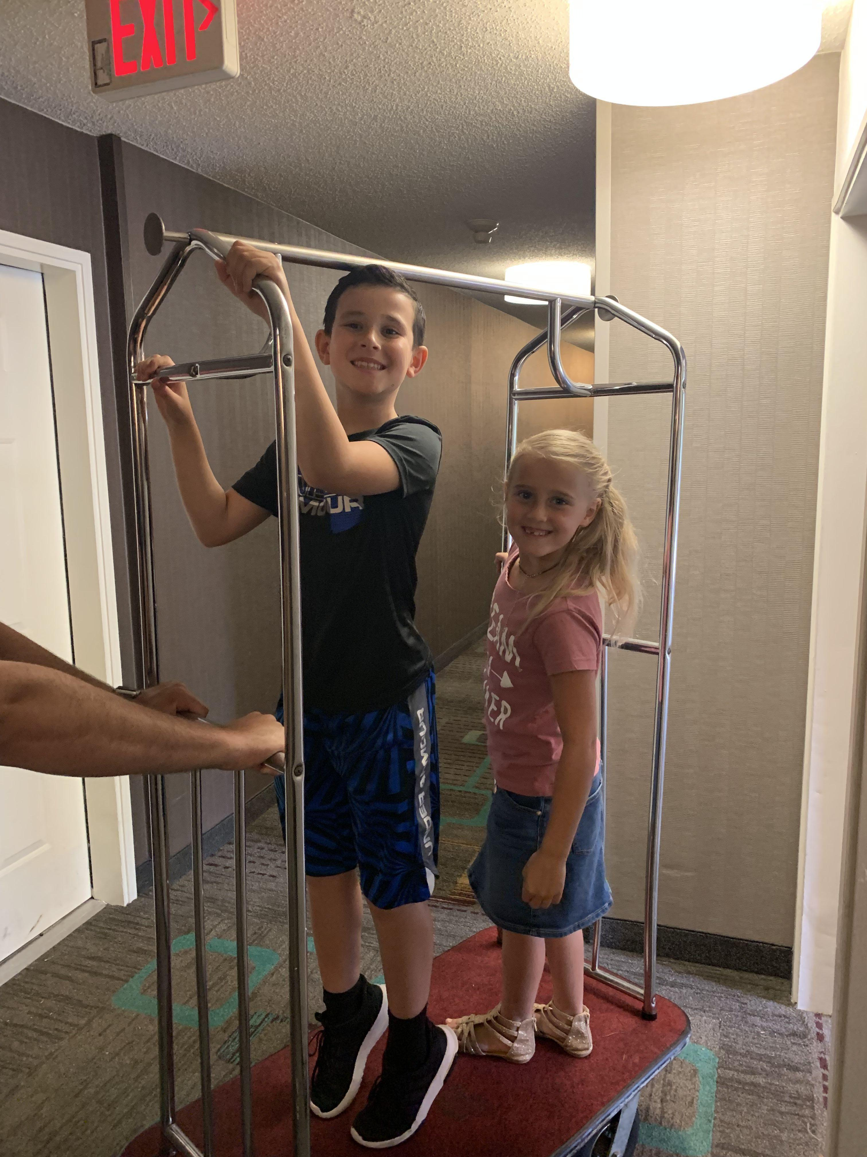 Kids on a Luggage Cart at Residence Inn Marriott Branson