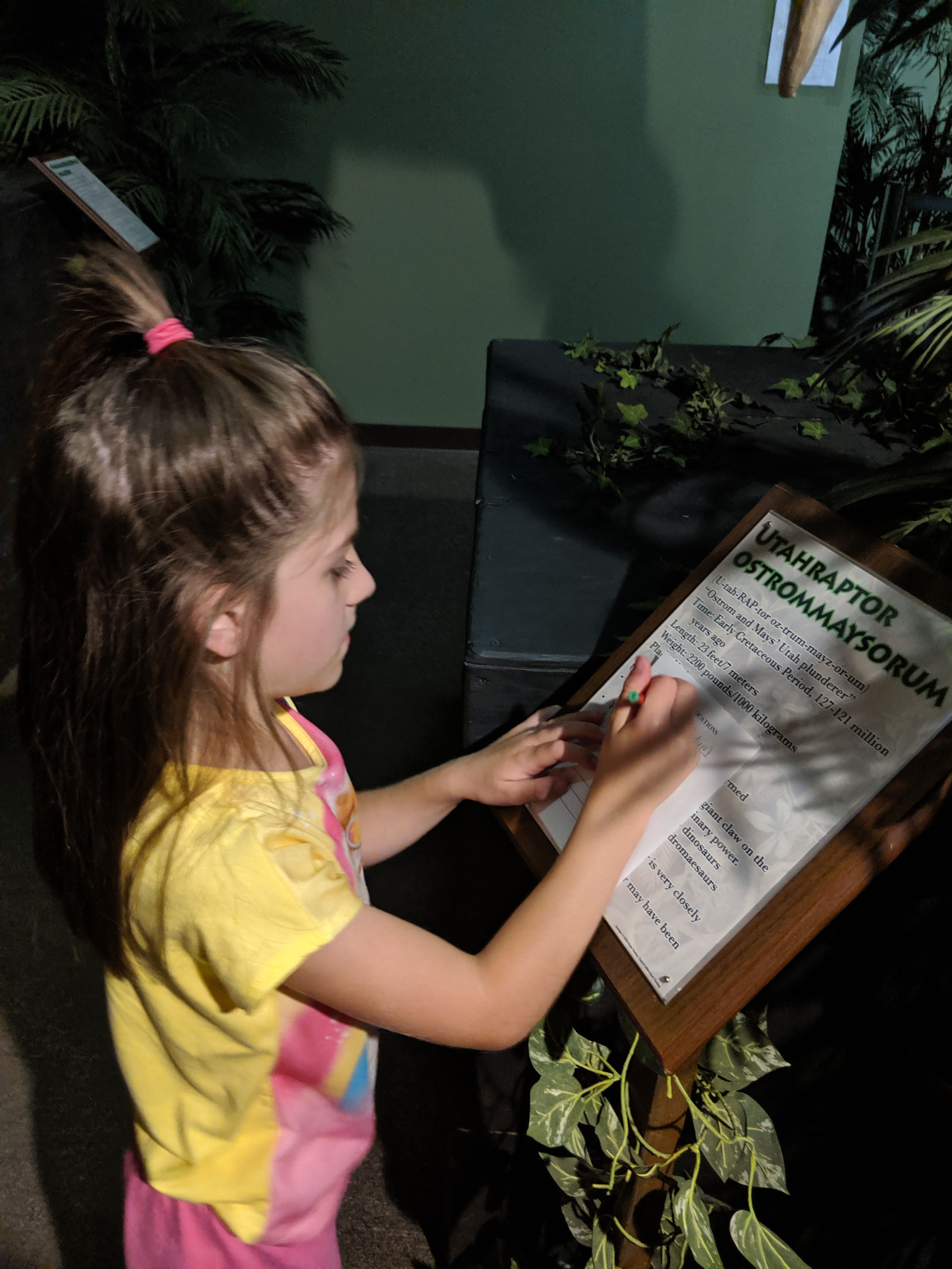 Young Girl at the Dinosaur Museum