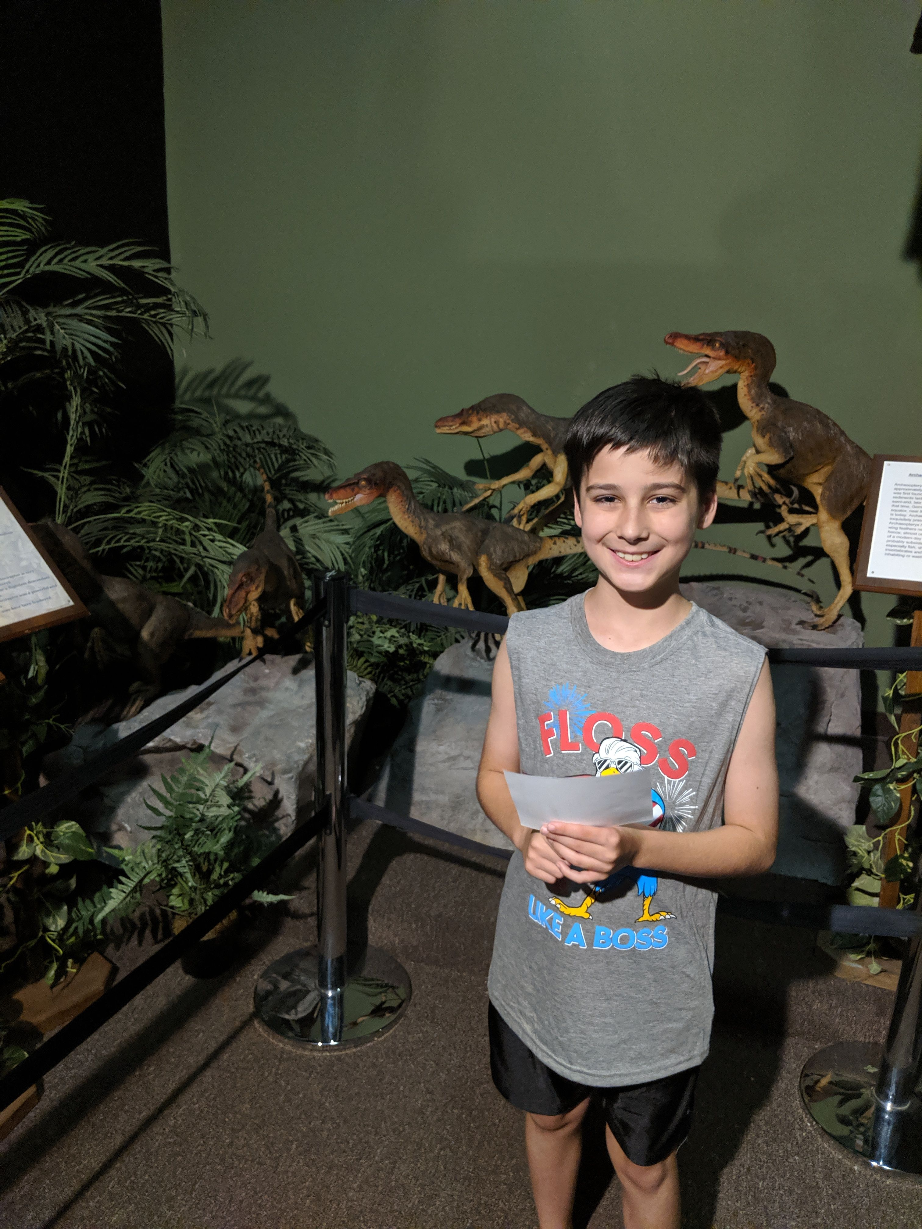 Young Boy at the Dinosaur Museum