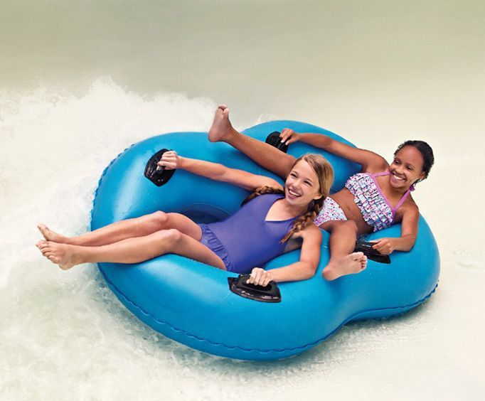 Girls Slide Down Waterslide at Water Country USA