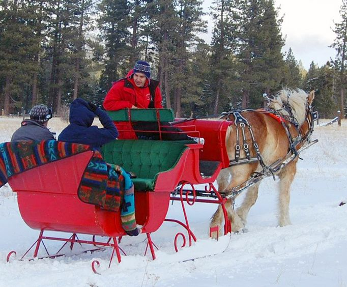 Red Sleigh with the Sunset Sleigh Ride and Dinner