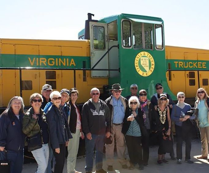 Group in Front of a Train with the Wild West Tour
