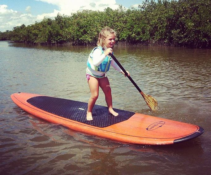 Young Girl on the Dolphin and Manatee Stand Up Paddleboard Tour