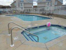 Outdoor Swimming Pool of Hawthorn Suites by Wyndham Green Bay