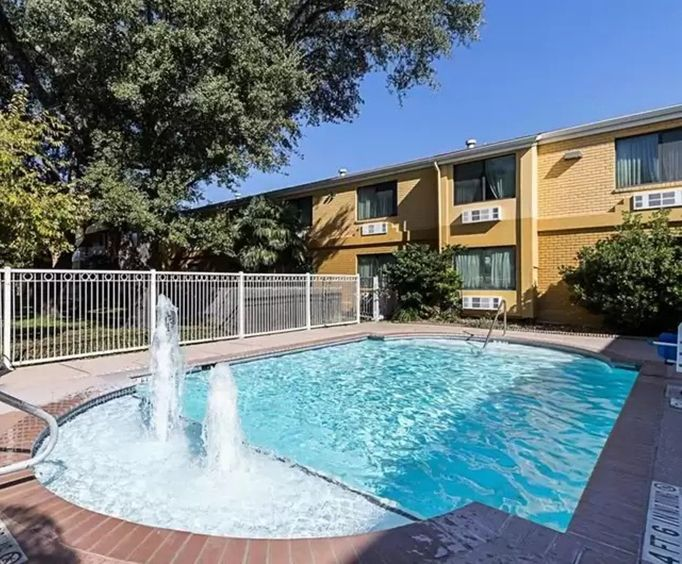 Outdoor Pool at SureStay Plus Hotel by Best Western San Antonio North