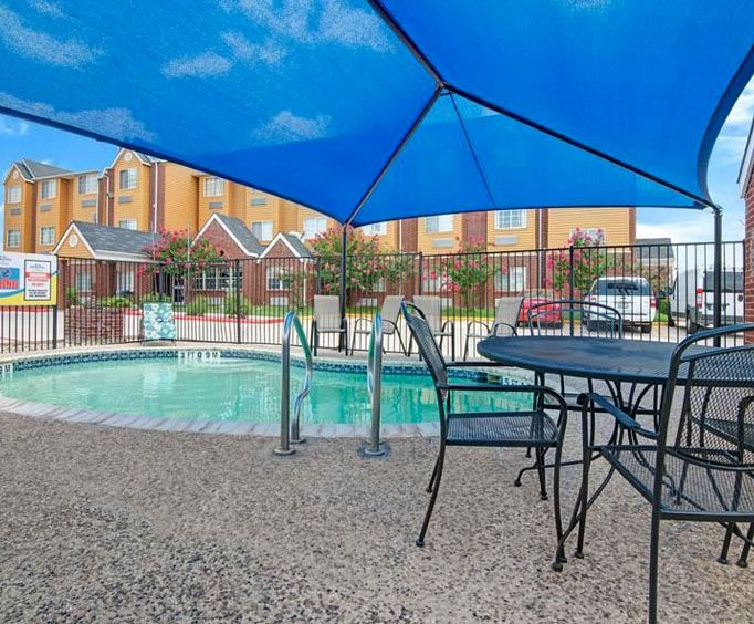 Outdoor Swimming Pool of Microtel Inn  Suites by Wyndham San Antonio North
