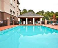 Outdoor Pool at Hampton Inn & Suites Chapel Hill/Durham, Area