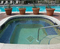 Outdoor Pool at Quality Inn and Suites Golf Resort