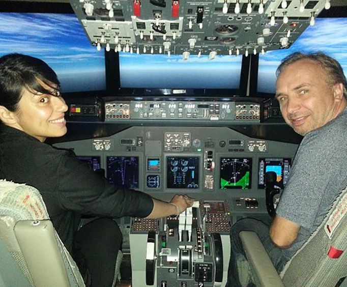 Couple Piloting the Boeing 737 Flight Simulator Experience