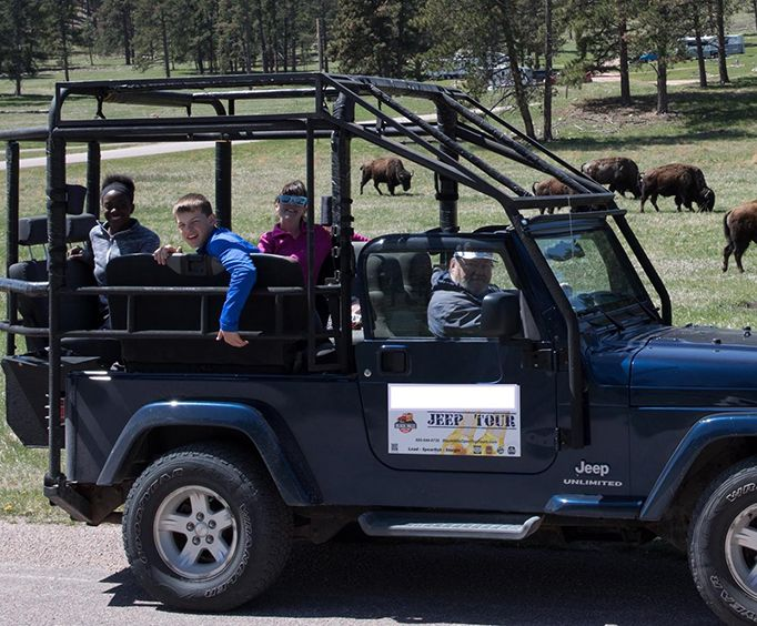 Children in Jeep on Custer State Park Safari Jeep Small Group Tour