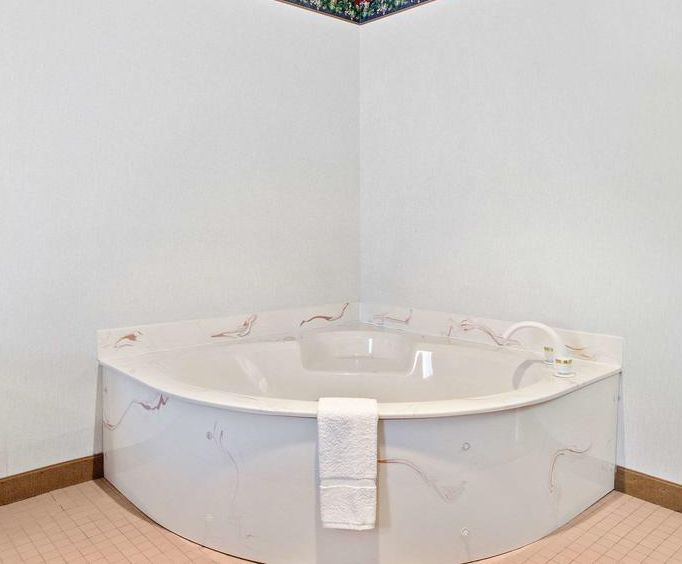 Photo of Quality Inn Hill City Jacuzzi Room