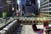 Enjoy a BBQ feast while viewing the bustle of Broadway and Times Square