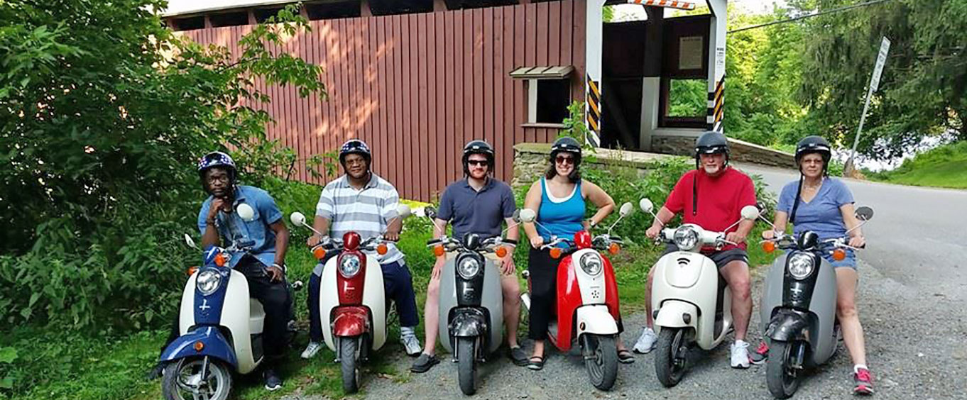 Group on Vespas for the Small Group Strasburg Covered Bridge Tour by Single Seat Scooter
