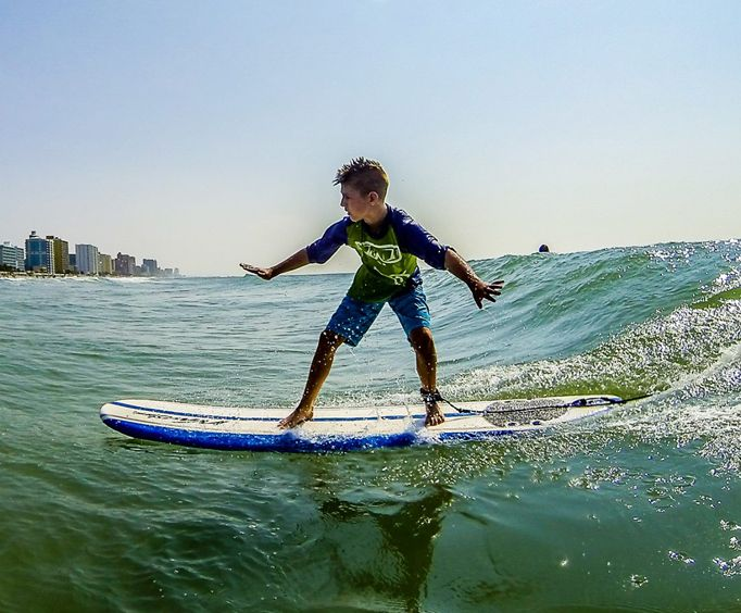 Young Boy Enjoying Myrtle Beach Surfing Lessons