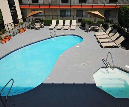 Outdoor Pool at Econo Lodge Inn & Suites
