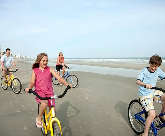 Family on the Beach with an All Day Cocoa Beach Bike Rental
